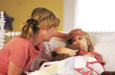 Mother taking care of ill child